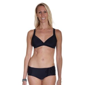 Front view of a woman wearing a Local Honey Kathryn black colored bikini top