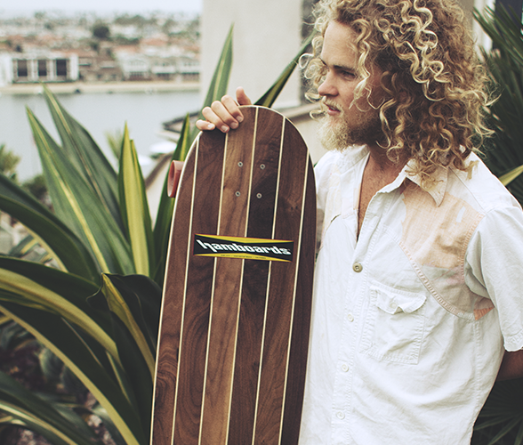 Hamboards Logger loongboard standing with long haired man.