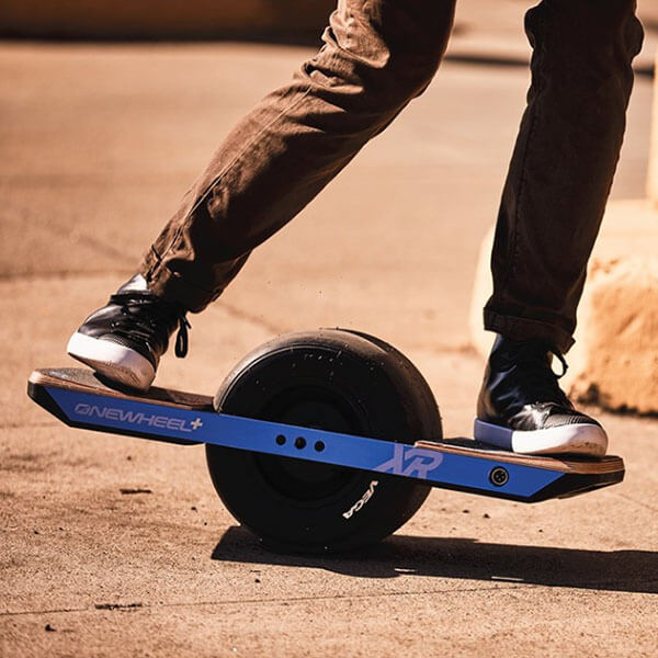 Someone riding the new OneWheel XR in the dirt.